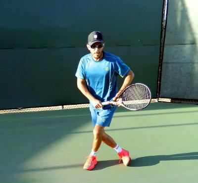 Carl Bryan shuffle back to center of tennis court