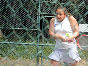 Female tennis player with energy and concentration